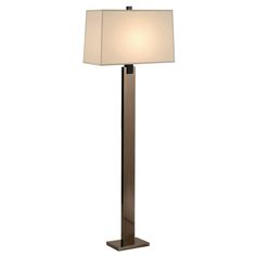 The Monolith Floor Lamp glorifies any space with its beautiful design and solid construction. A strong rectangular base supports a thick metal column that is interlocked with a rectilinear natural linen shade. Embedded with a 150W medium base bulb, the floor lamp emits a diffused luminance across the room. This floor lamp is offered in black nickel and black brass metal finishes, and a 3-way switch is also provided along for easy operation. - Olighting