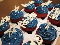 Not only do these New England Patriots cupcakes spell out who they're rooting for in white chocolate which, along with the red velvet cake and blue frosting form red, white and blue, they're made by W Desserts, based in Stoughton, Massachusetts, and run by Maura Wilson, who works as a graphic designer for the Patriots and makes cupcakes in her spare time!