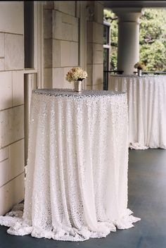 Silver sequin tablecloths gussy up a cocktail hour | Photography: J Wilkinson Co - www.jwilkinsonco.com Read More: http://www.stylemepretty.com/2014/08/13/tented-arabian-wedding-in-texas/