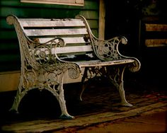 A decorative white bench that sits in front of a store in Port Dover, Ontario, Canada.