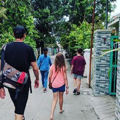 Following family down residential streets of Hoi An in search of food