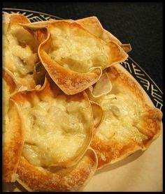 Artichoke Wonton cups for an appetizer :)                                         These are so fun and easy to make!