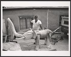 Citation: Leroy Archuleta with wooden elephant sculpture, ca. 1988 / unidentified photographer. Chuck and Jan Rosenak research material, Archives of American Art, Smithsonian Institution.