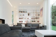 Designed by monovolume architecture + design, House M is located in Meran, Italy. The house was completed in 2012 with a design that strove to blend Living Room Grey, Rugs In Living Room, Living Room Designs, Living Spaces, Small Living, Modern Living, Modern Family, Modern Wall, Home Library Design