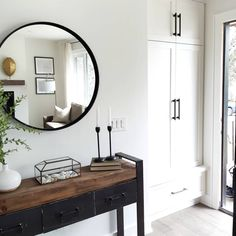 From a dark space to a usable light space. Flipping homes, one at a time Entryway, built in entry closet, home styling, table decor. Flipping Homes, Entry Closet, Fixer Upper House, Build A Closet, Light And Space, Front Entrances, Modern Traditional, Round Mirrors, Clean Lines