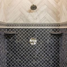 Like the pattern of the cream tiles contrasting the black tiles. Perhaps all in the same creamy white color family but the arabesque ties on the floor and the entire shower pattern herringbone as here.