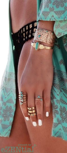 Bikini, layered fine jewellery stacked with cuffs, and a great tan
