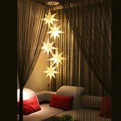 Solar-powered star outdoor lights hung from the trees that illuminate at night. Over a picnic table or a hammock. Available from PartyLights.com.