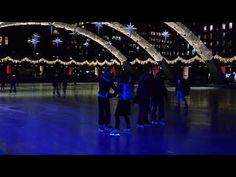 Skating at Nathan Phillips Square at night