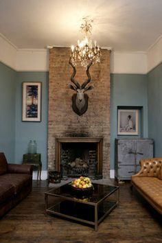 blue living room Love the molding & the fireplace too