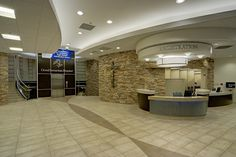 I love the stone wall behind their registration area. (Lobby Information Center??)