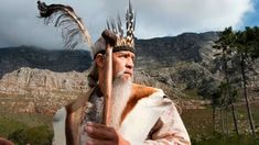 Khoisan leader Ockert Lewies begins a prayer for rain at the foot of Table Mountain, on May 25, 2017