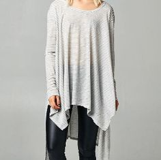 Grey and white stripes, asymmetrical tunic. Sm thru lg. $34.  Tula J Boutique is a trendy boutique in Trussville, AL that carries ladies and tween clothing, purses, shoes, jewelry, accessories, and more! Call (205) 655-5333 or stop by TODAY!