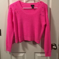Cropped Hot Pink Sweater Hot pink sweater, cropped with studs on the shoulder. Worn one time. Rue 21 Sweaters