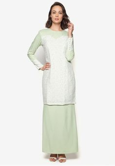 Baju Kurung Modern from Gene Martino in White and Green Gene Martino returns with a modernized take on your traditional wear. The Baju Kurung Moden features a floral lace embroidered front panel, accompanied by a slender silhouette while keeping it modest and chic.  Top - Polyester - Round neckline - ... #bajukurung #bajukurungmoden