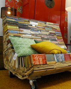 """CHAIR MADE FROM OLD BOOKS Alvaro Tamarit has collected and re-purposed an array of old books in order to create the """"Banco del Pensamiento"""" (""""The Bench of Thought""""). The piece can be touted as a sculptural work of art, but also functions as a seat thanks to the base which is reinforced with wood and a glossy varnish which adds resilience and protection to the otherwise delicate paper book covers"""