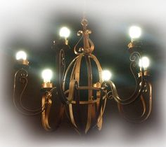 Forged iron chandeliers for a hacienda living room and traditional foyer. Hacienda Homes, Hacienda Style, Hotel Foyer, Wall Lights, Ceiling Lights, Iron Chandeliers, Spanish Style, Ceiling Lamp, Wall Sconces