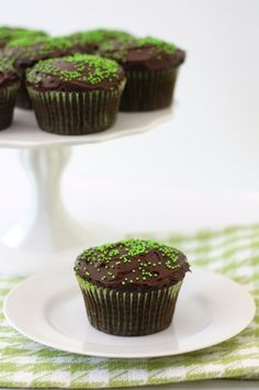 Chocolate Zucchini Cupcakes Recipe on twopeasandtheirpod.com Super moist and rich cupcakes!