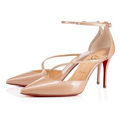 """Fliketta's"" asymmetric cross strap is the image of understated glamor. In nude mother of pearl effect patent leather, this 85mm d'Orsay is finished with a chic receded heel and slender ankle strap."