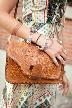 Light brown leather satchel with intricate floral design