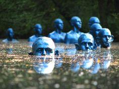 Eerie blue men submerged under water warn of climate change