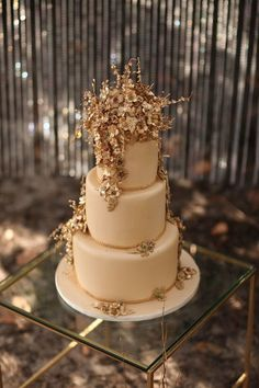 glamorous wedding cake with gold leaves