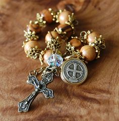 Olive wood chaplet. One Decade Prayer 10mm Olive Wood Beads Bracelet. Swarovsky Crystyal. St.Benedict Medallion.  Out of the ground, the Lord God made to