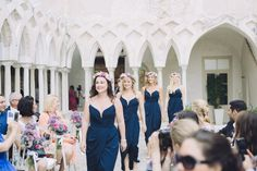 Bridesmaids wear navy blue dresses and flowercrowns | Photography by http://www.roncaglioneweddingphotographers.com/