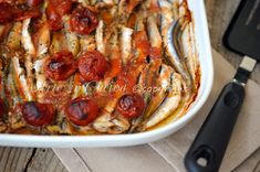 Alici al pomodoro in tortiera al forno