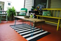 porch: yellow bench and black striped rug
