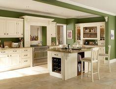 Green walls, white cabinet kitchen