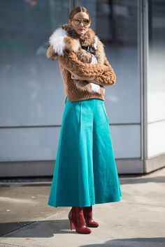 Olivia Palermo wearing a cable knit sweater with fur and a teal midi skirt
