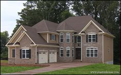 3,281 Sq Ft custom home with 5 bedrooms, 4.5 bathrooms. Brick and shake exterior with courtyard entry garage and a turret sitting area in formal dining room and master suite above.