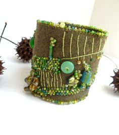 Fragments in green fiber art cuff by Cesart64 on Etsy, $59.00