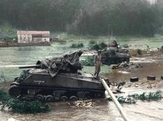 The position on which the tanks are put in place is under-emergence following heavy rains which fell at this time of year. The M4 Sherman, equipped with a 105mm gun, belongs to the 756th tank Battalion. The ax of fire suggests that the tanks supports their fires the troops engaged for the price of Saint Dié which is 15km as the crow flies. The 105mm gun was devoted to infantry support & not anti-tank fighting. 8 November 1944, Les rouges-eaux, France.