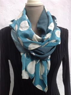Add an infinity scarf to a long one and twist stylishly!!!  Voila!