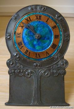 Liberty & Co pewter/enamel clock....love this!!