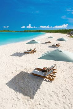Sun loungers on the secluded beach at Sandals Emerald Bay, Bahamas