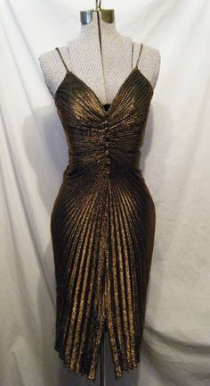Gold Lion vintage 1970s Sparkling Disco dress with pleats and Buttons Extra Small. $18.00, via Etsy.
