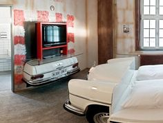 Located in Stuttgart, Germany - a German international hub for car dealers - the Hotel is a paradise for car enthusiasts. The hotel featu. Car Part Furniture, Unusual Furniture, Automotive Furniture, Recycled Furniture, Handmade Furniture, Furniture Decor, Modern Furniture, Furniture Design, Automotive Decor