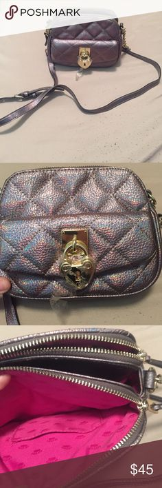 Authentic juicy couture cross body purse brown This adorable purse is in very good shape! Was well taken care of and is almost in like new condition. Still had the protective cling on heart! I consider all offers! Juicy Couture Bags Crossbody Bags