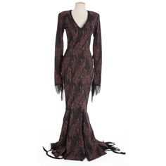 Morticia's dress | The dress worn by Anjelica Huston for the majority of the first film. I bet you didn't realise it was red.