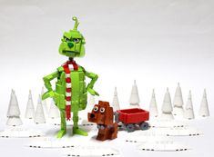 Grinch and Max | Inspired to build Grinch and Max from The G… | Flickr Lego Duplo, Lego Toys, Lego Christmas Ornaments, Lego Christmas Village, Lego Winter, Lego Mecha, Legos, Le Grinch, Lego Advent Calendar