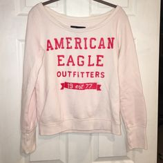 American Eagle sweatshirt. Small. Boatneck. Pink American Eagle sweatshirt. Small. Boatneck. Pink. Loungey, comfy. Red logo writing. Distressed look. Worn washed a few times. Tiny stain on from under A in eagle. See pic fast shipping bundle discount. American Eagle Outfitters Tops Sweatshirts & Hoodies