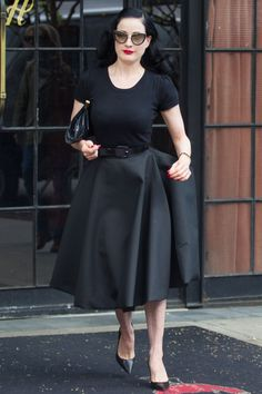 Classic Monochrome . A plain black tee teamed with a black full skirt and black accessories. Slimming, sophisticated and perfect for a day when you cant be bothered to match things.