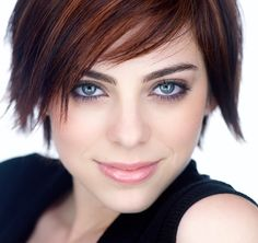 Hair-auburn color+ highlights, cut-short bob, sidepart, sideswept bangs with piecey flicks; Makeup-lavender on lids used w blues eyes!, pale pink lips, Headshot of Krysta Rodriguez