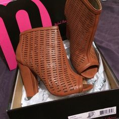 "Sexy cut out booties. Must have!!!! Sexy Michael Antonio ""Judah"" in cognac PU worn once so sexy! Thick heel, laser cut, open toe bootie. Hot ! Michael Antonio Shoes"