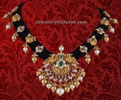Silk thread necklaces are in trend. Own this beatifully designed pecock pendant black color rope model necklace adorned with south sea pearls and flat diamonds encrusted in gold. For details contact  P.Satyanarayan & Sons Jewellers, Hyderabad Whatsapp at +91 7680-944450/098490 44450 Related PostsTraditional Gold Black Dori necklaceDori Silk Black Rope Gold NecklaceNakshi Black Cord NecklacePuligoru Chain …