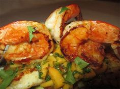 Pan-seared flounder and shrimp with peach relish. A simple seafood supper gets a summertime twist with the addition of fresh peach relish.