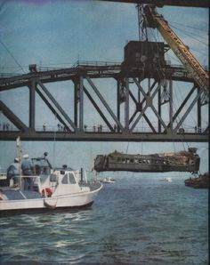 "1958 FACE OF AMERICA vintage magazine article ""Death on the 8:28"" ~ The tragic relic being hoisted out of the water at left is one of three commuter coaches that plummeted to the bottom of Newark Bay. On the fateful morning, the Jersey Central's Train No. 3314 was carrying over one hundred men and women to Manhattan. ... Photograph by Hans Knopf ~ Size: The dimensions of each page of the two-page article are approximately 10.5 inches x 13.5 inches (26.75 cm x 34.25 cm). Condition: This ..."